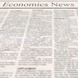 Newspaper with headline Economics News and old unreadable text royalty free stock photos