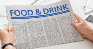 Newspaper with the headline Food and Drink Royalty Free Stock Photo