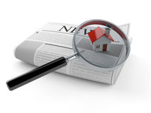 Newspaper with house and magnifying glass Royalty Free Stock Photography