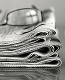 Newspaper. Image of pile of newspaper representing world news with glasses Royalty Free Stock Photography