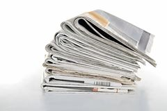 Newspaper. Image of a stack of newspaper on white background Stock Photos