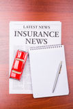 The newspaper INSURANCE NEWS and auto Stock Photo