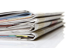 Newspaper, journal. Several newspapers, journals stacked on white background Stock Images