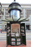 Newspaper Kiosk.San Francisco. Newspaper Kiosk on San Francisco street with shopping mall in the background royalty free stock photos
