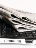 Newspaper on laptop Royalty Free Stock Images