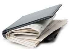 Newspaper and a laptop Stock Images