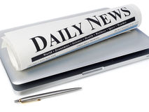 Newspaper on laptop Royalty Free Stock Photography