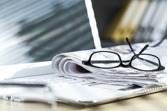 Newspaper on laptop Royalty Free Stock Photos