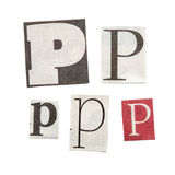 Newspaper Letters. Set of letters cut out from different news papers and magazines as design elements Royalty Free Stock Photo