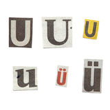 Newspaper Letters. Set of letters cut out from different news papers and magazines as design elements Stock Photo