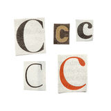Newspaper Letters. Set of letters cut out from different news papers and magazines as design elements Stock Photography