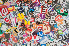 Newspaper Letters - Texture. Many mixed letters forming a colorful background Stock Photos
