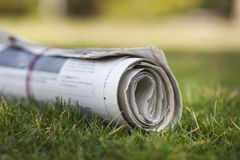 Newspaper. The Media Grass Paper Rolled Up Delivering Event Stock Photography