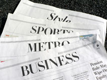 Newspaper - newspaper sections. Display of newspaper sections stock photos