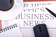 Newspaper, notebook, mouse and cup of coffee Stock Image