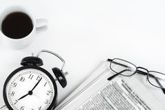 Newspaper and o'clock on white background Royalty Free Stock Image
