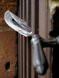 Newspaper and old door handle. Newspaper in an old door of a historical building in Wissembourg, France Royalty Free Stock Image