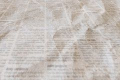 Newspaper with old vintage crumpled texture background royalty free stock photo