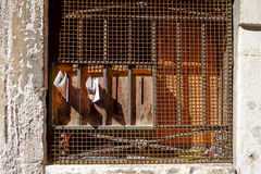 Rusted metal grid. Newspaper and old window with rusted metal grid Stock Photo