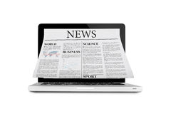Newspaper Out Of Laptop Stock Images