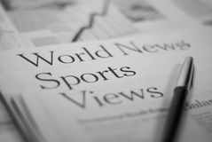 Newspaper pages. World news, sports, views with a pen Stock Photography