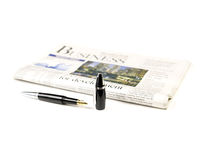 Newspaper and pen Stock Images