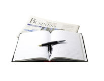 Newspaper, pen and notebook. On white background Royalty Free Stock Image