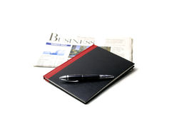 Newspaper, pen and notebook. On white background Royalty Free Stock Photography