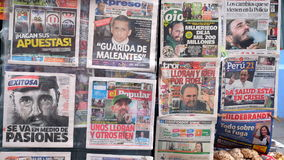 Newspaper in Peru covering Castro`s death in a newspaper booth on the street. Royalty Free Stock Photos