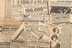 Newspaper pieces vintage advertising Old magazine strips. Newspaper pieces with vintage advertising. Old magazine strips royalty free stock photography
