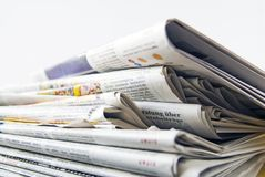 Newspaper pile Stock Images