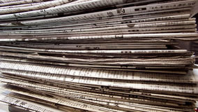 Newspaper pile Stock Photo