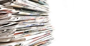 Newspaper pile. On white background Stock Photo