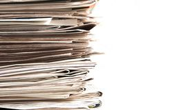Newspaper pile Stock Image