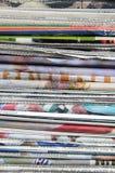 Newspaper pile Stock Image