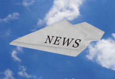 News, hot news, fast arriving - Newspaper plane. Plane made out of newspaper, with the word NEWS written on it, on blue sky. Illustrating the concept of news Royalty Free Stock Images