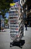 A newspaper pole on a street