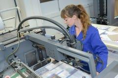 The newspaper printing machine. Operator stock photos
