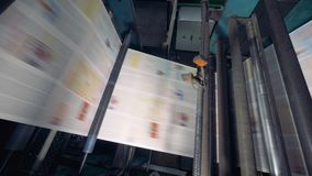 Newspaper printing by printing press at printing house. stock footage
