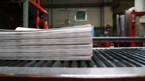 Newspaper printing process in printing house stock video