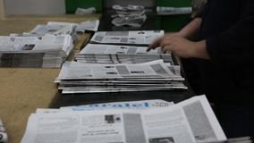 Newspaper prints shooting of the publishing business. stock video