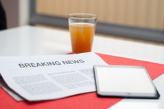 Newspaper read at breakfast Stock Images