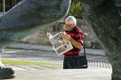 Newspaper reader, Viana do Castelo, Portugal Royalty Free Stock Photo
