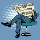 Newspaper reading man Stock Photography