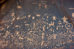 Newspaper Rock. Is a petroglyph panel etched in sandstone that records approximately 2,000 years of early human activities.  It is located near the Needles Stock Images