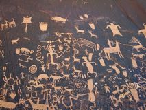 Native American Petroglyphs. Newspaper Rock in Canyonlands is a popular Utah tourist attraction and well known for the numerous petroglyphs at the site Royalty Free Stock Photography