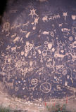 Newspaper Rock Petroglyphs. Over the centuries many Native American carved symbols and other art Ipetroglyphs) into the rock and desert varnish of Newspaper Rock Royalty Free Stock Images