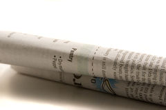Newspaper rolled Stock Photo
