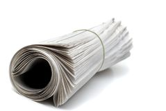 Newspaper Rolled Up. Rolled up newspaper isolated on white background Royalty Free Stock Images