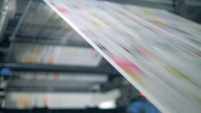 Newspaper rolling on a typographic conveyor, automatic production. 4K stock video footage